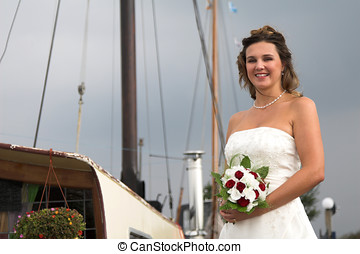 Bride in the harbour - beautiful bride posing in front of...