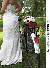 Dutch bride - Bride with a bicycle and her weddingbouquet...