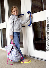 School time - Young grade school age girl heading off to...