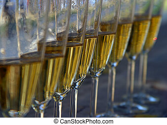 Wine-glasses - Glasses filled with champagne