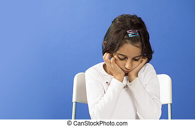 sad little girl in classroom
