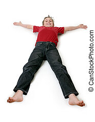 Boy lying down - A boy lies outstretched on a floor.