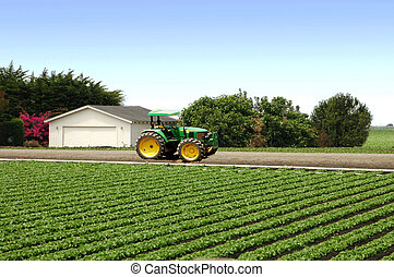 Farm Tractor - A farm setting with the tractor parked and...