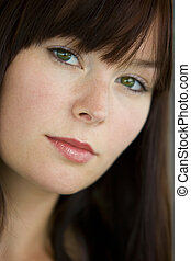 Contemplation - A beautiful young woman with green eyes...