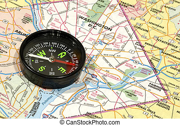 Compass - Photo of a Compass on a Map - Travel Concept