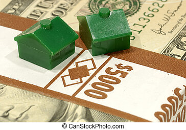 Monopoly - Miniature Houses on a Stack of Money