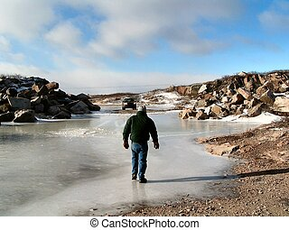 Walking on Thin Ice - A man walks on thin ice