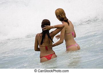 Copacabana Beach - Young Brazilian girls playing in the surf...