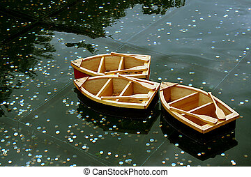 Wooden Boats - Wooden boats on wishing pool.