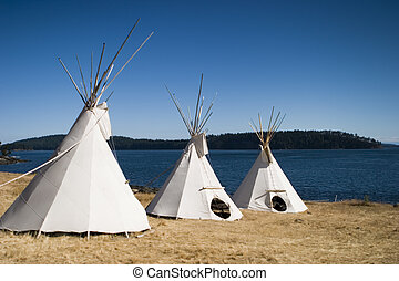 Three Teepees Together - Three teepees are lined up in a row...