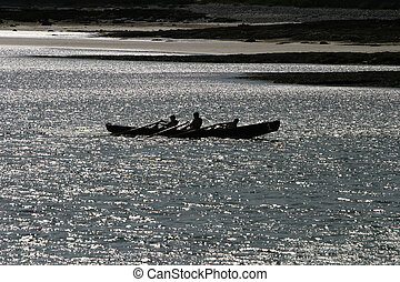 Three Lads Rowing - Three young men or boys rowing in a boat...