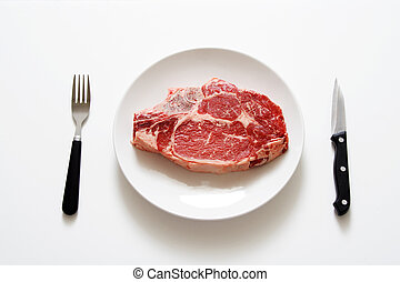Steak - Raw steak on a plate