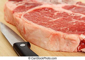 Ribeye steak - Close up of a ribeye steak and a knife