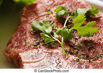 Ribeye steak - Seasoned ribeye steak being prepared for...