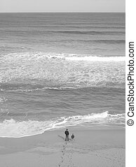 Fatherhood - Son and father on the coast Black and white...