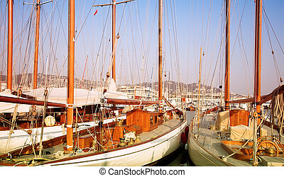 Two yachts in Cannes, France - Expensive wooden yachts tied...