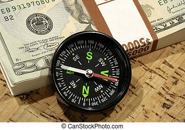 Market Direction - Photo of a Compass and Cash - Market...