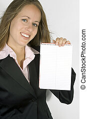 Advertisement on a Notepadworkbook - A business executive is...
