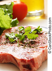 Ribeye steak - Seasoned ribeye steak ready for cooking