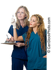 Healthcare workers - two nurses working together looking at...