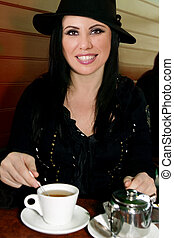 Female having a cup of tea - Female sitting in a cafe and...