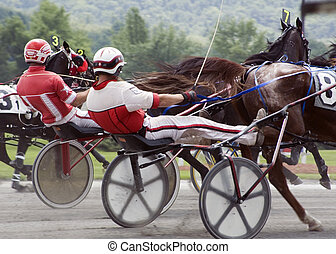 harness race-2 - closeup of sulky and drivers close race