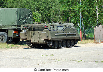 Military industry, tank and truck. - Tank and truck. War...
