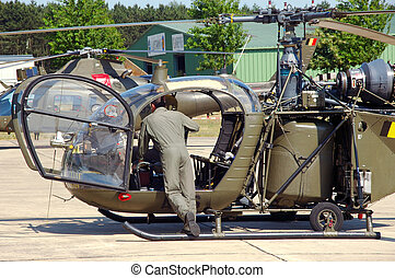Military industry, helicopter and pilot. - Pilot checking...