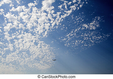 airplane departure - wide-angle shot of clouds and airplane