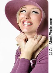 Happy smiling woman in large brimmed sunhat - Friendly...