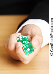 Roll a dice - A businessman rolling a dice