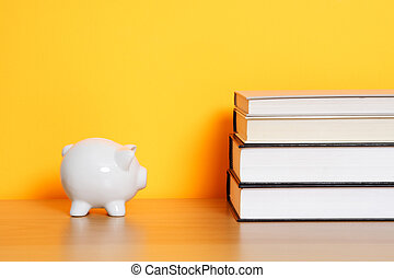Saving for college - A piggy bank and a stack of books, can...
