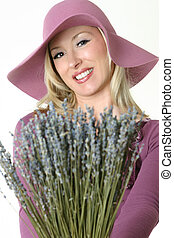Lavender Girl - A female holding a bunch of dried lavender...