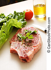 Ribeye steak - Seasoned ribeye steak ready for grill