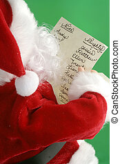 christmas santa reads his christmas santa list