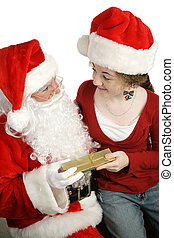 Gift From Santa - A girl sitting on Santa\\\'s lap and...
