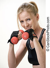 working out - Attractive woman working out with three pound...