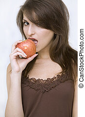 girl posing with red apple - beautiful girl standing holding...