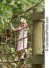 young girl playing on climbing frame 01