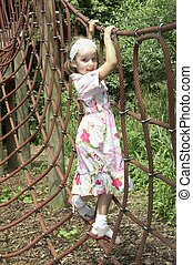 young girl playing on climbing frame 02