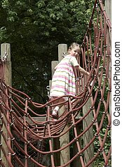 young girl playing on climbing frame 03