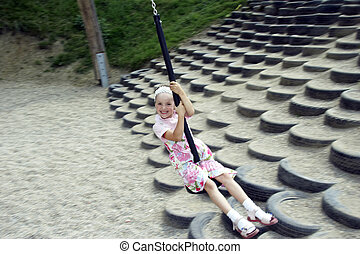 young girl swinging 02