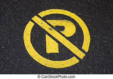 no parking - yellow no parking symbol painted on blacktop