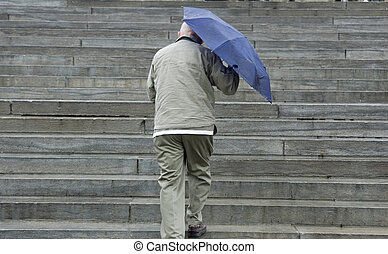 up the steps - man walking up stone steps of canadian...