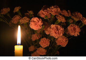 Carnations by candle - A bunch of carnaitons partly...