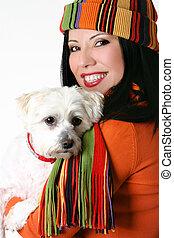 Female cuddling a pet dog - Joy of pets. Beautiful woman...