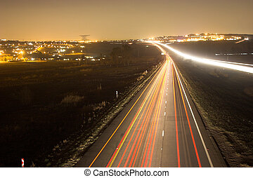Lights - Night scene with city background over busy highway