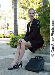 Resting business woman - Blonde business woman sitting...