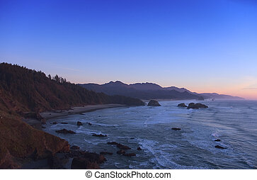Cannon Beach, Oregon and sea just after sunset, camera Nikon...