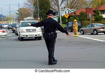 Directing traffic - NY State Trooper directs traffic at...